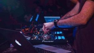 dj-operating-a-disc-mixer