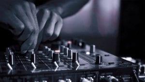 dj-using-mixing-console